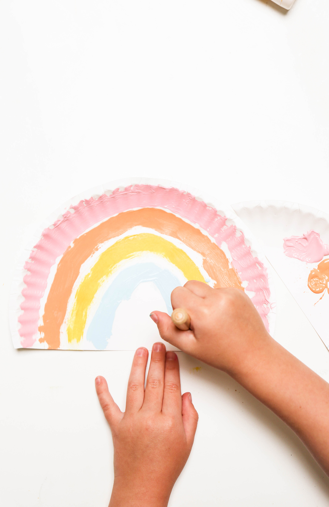 painting paper plate rainbow