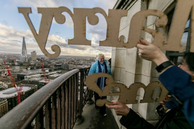 As the couple reached the top of St Paul's they came across a sign saying 'Marry Me'