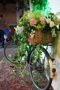 Vintage bikes strewn with flowers add a romantic feel