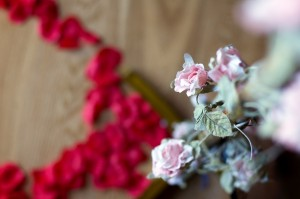 Romantic flowers and rose petals decorated the flat