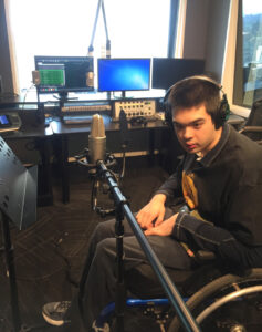 Young man at radio station
