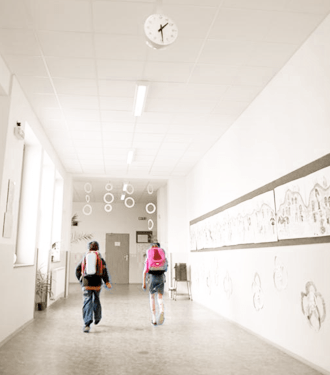 Children with backpacks walking in hallway with clean indoor air quality