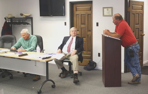 Jay Winner, Executive Director LAWCD, Bart Mendenhall, Attorney for LAWCD, and Alan Frantz of Rocky Ford, discuss Fountain Creek issues.