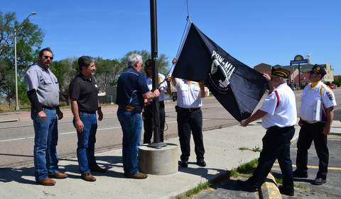 Raising a Flag Honoring POWs