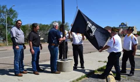 Raising a Flag Honoring POWs