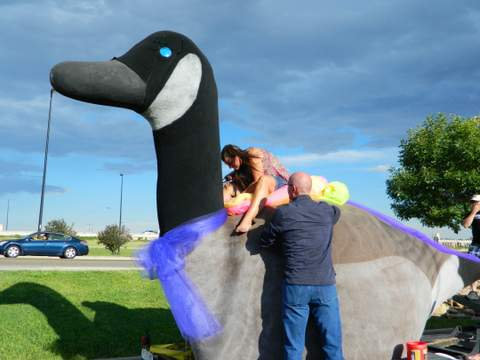 Bob DeLancey and Holly Burton Work on the Float