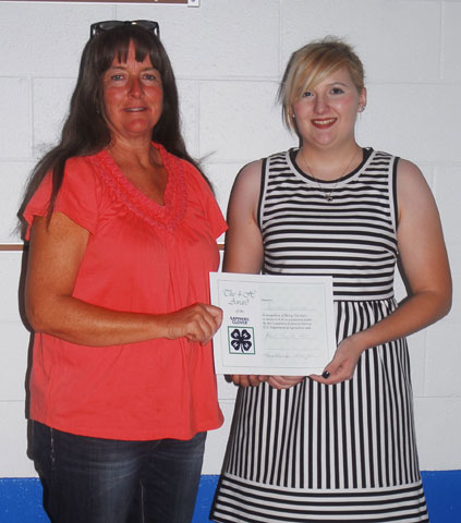 Meritorious Service winner Teresa Garcia is pictured with Senior Outstanding 4-H Member Dominque Cardinelli.