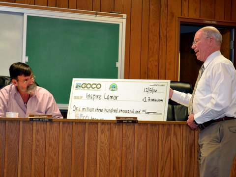 Mayor Roger Stagner and Administrator Sutherland Display GoCO Check