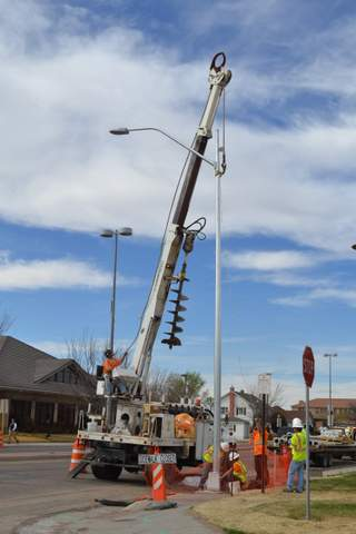 Work Crews Installing New Light Near City Complex