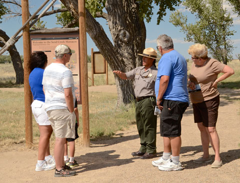 NPS Park Guide Mario Median explains the Sand Creek Massacre to visitors. NPS Courtesy Photo