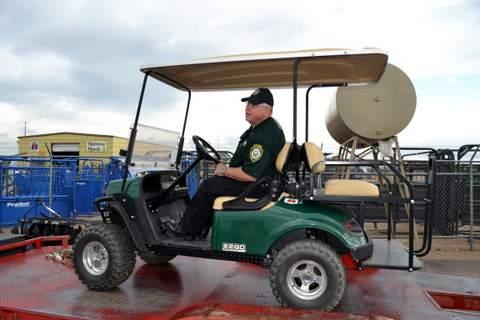 Posse Deputy Settles, Easing Cart off the Trailer at Big R