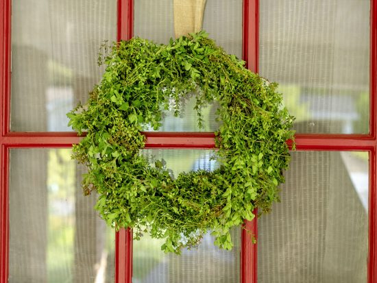 Create a simple wreath using the excess herbs in your garden. Herbs are a great crafting medium that will bring wonderful scent and texture to a handcrafted wreath.