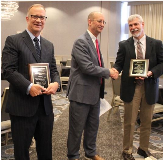 Dr. Bianchini (L) and Dr. Greve (R) receive awards from Dr. Chafetz. The two were honored last month for their distinguished contributions in psychological science by the Louisiana Psychological Association