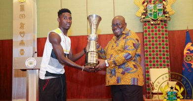 President Akufo-Addo being presented with the trophy by Captain Isaac Twum