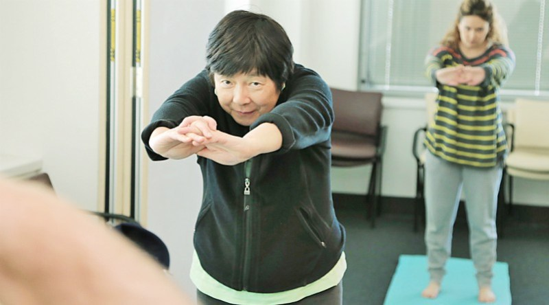 Wai-Jen Lee at the WSLHD Wellbeing Festival stretching class at Auburn.