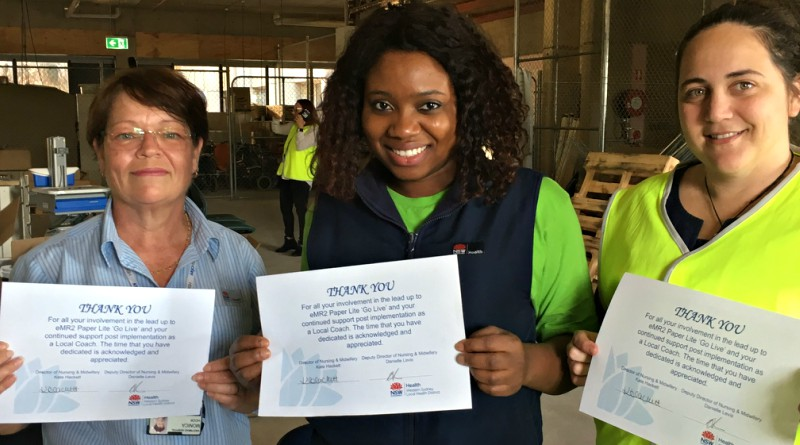 Midwife Monica Hook, clinical nurse educator Amenze Itoya and educator Kiara Dodd at the gathering to celebrate a successful first week of Paper-Lite at Westmead Hospital.