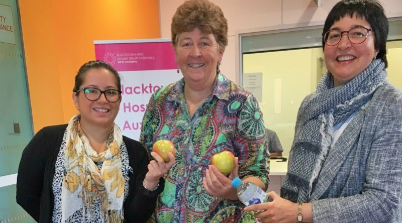 Maria Belisha, Jane Gentles with Anita Ray at the Blacktown Hospital Wellbeing Festival stall.