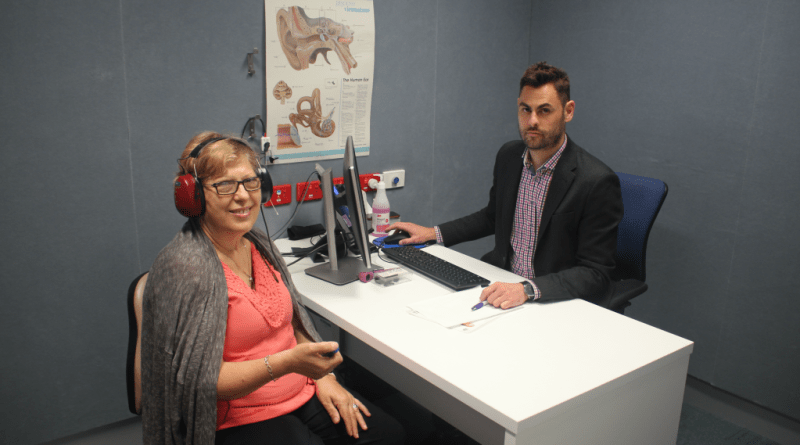 Audiology patient Maria Grasso and senior audiologist Mitchell Adair in a new hearing test room.