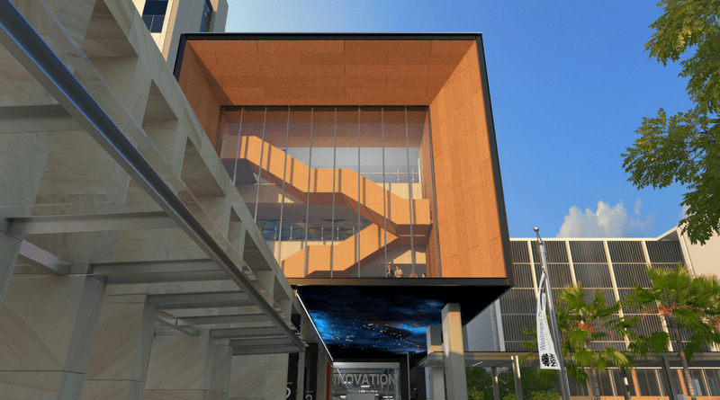 Front of the new hospital building with artwork under the ceiling of the exterior (image of night skies)