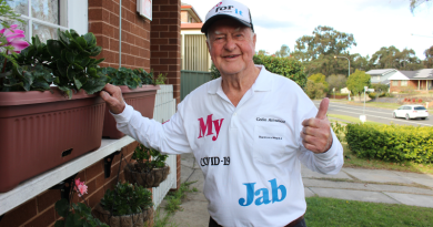 """""""Everyone at the clinic loved it!"""": 92-year-old western Sydney resident makes his own vaccination merch"""