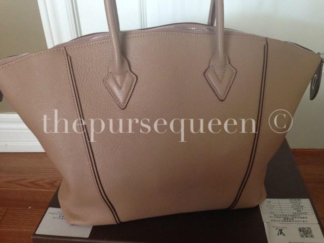 louis vuitton soft lockit beige replica vs authentic fake vs real back of bag