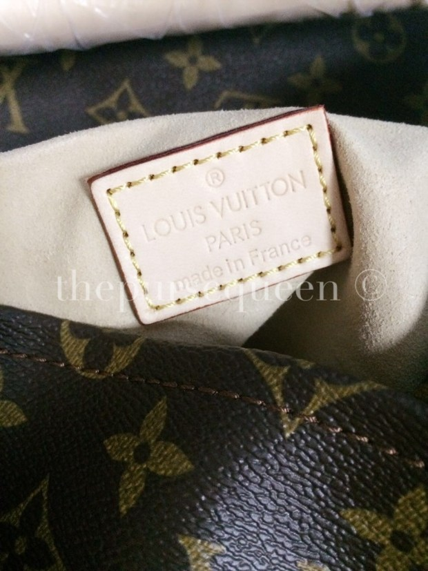louis vuitton artsy replica tag