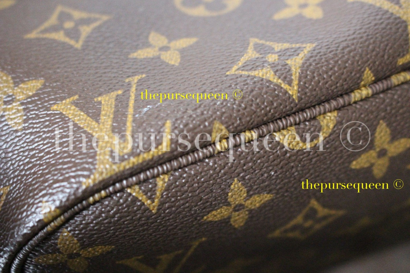 white marks on louis vuitton monogram canvas bag