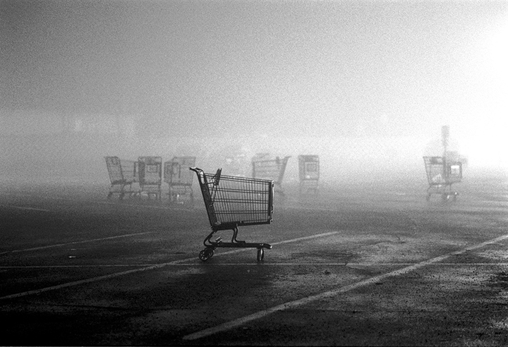 Lost shopping cart in the mid night fog