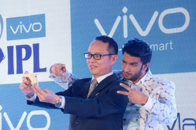Ranveer with Mr. Alex Feng, CEO of Vivo India at the launch event