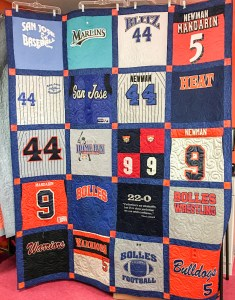 A beautiful t-shirt quilt made up of uniforms and jerseys by The Quilt Rambler Karen Overton