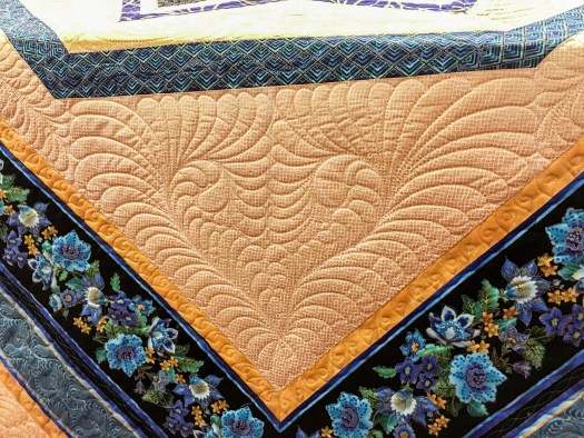 Custom Quilting Enhances the Piecing done on a Longarm Quilt
