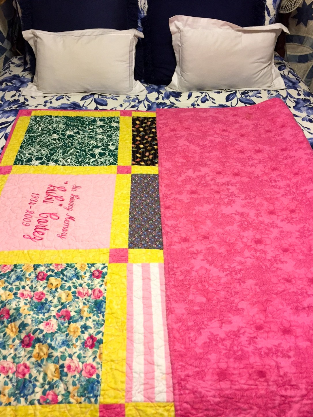 Photo shows the coordinating colors on the back and front of Lulus Memory Quilt