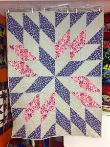 Starburst quilt pattern with three coordinating colors for a baby quilt