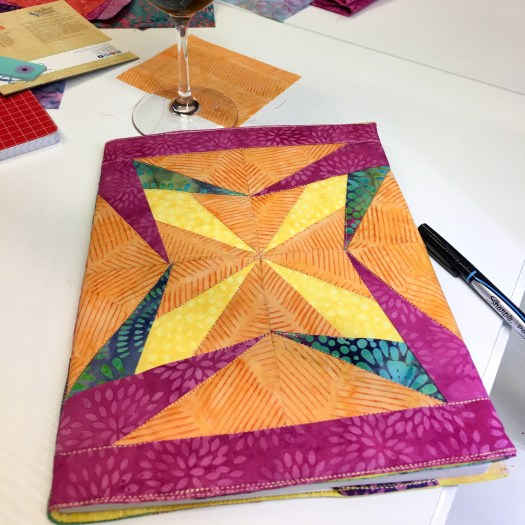 bright colors add to the beauty of this paper pieced composition notebook cover