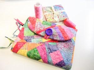 scrap pieced notebook cover in bright tropical Island Batik fabrics