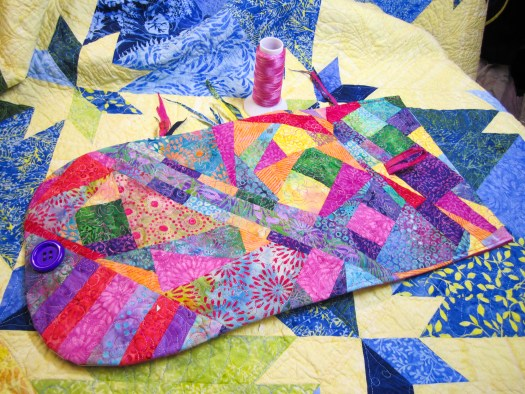 colorful patchwork scraps make a notebook cover using the foundation piecing technique