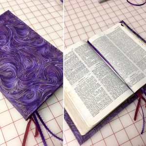 Majestic purple fabric covers a well read Bible