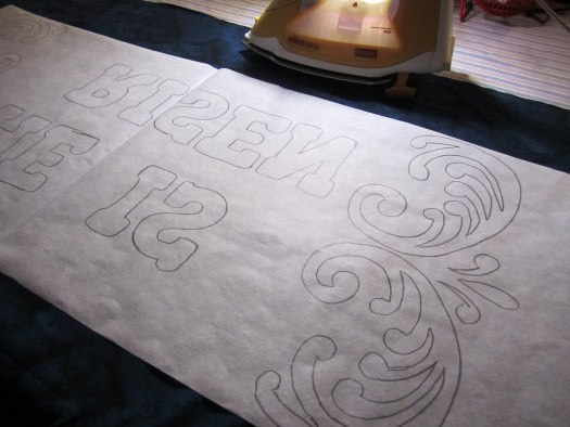 Designed traced in reverse on double sided fusible is applied to the wrong side of fabric with an iron