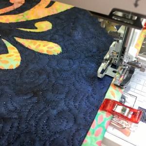 Machine Binding using Wonder Clips and colorful Island Batik Fabrics