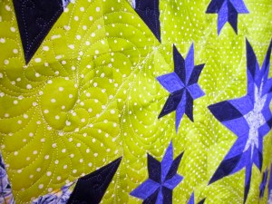 close up of hand guided quilt design element