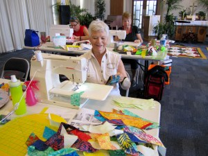 student is sewing colorful fabric in the quilting workshop with Karen Overton