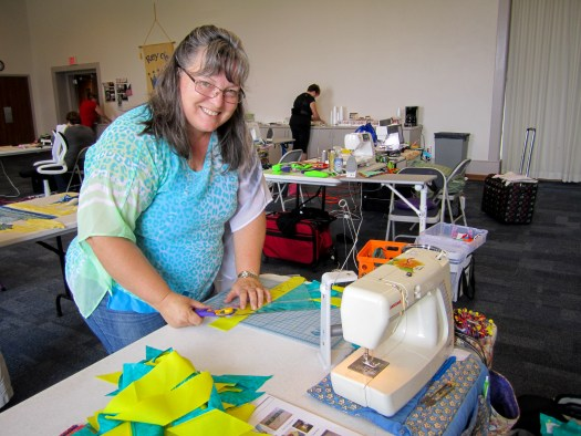 student in quilting workshop