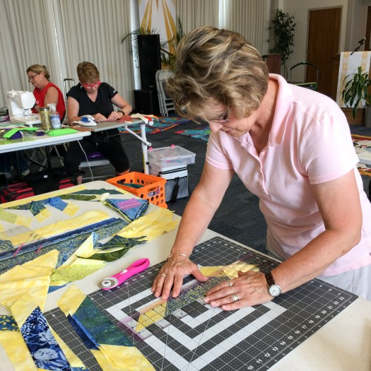 lady cutting out a quilting block