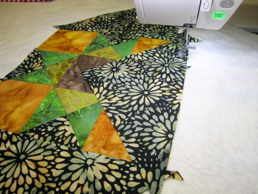 Adding setting triangles to the Quilt As You Go block