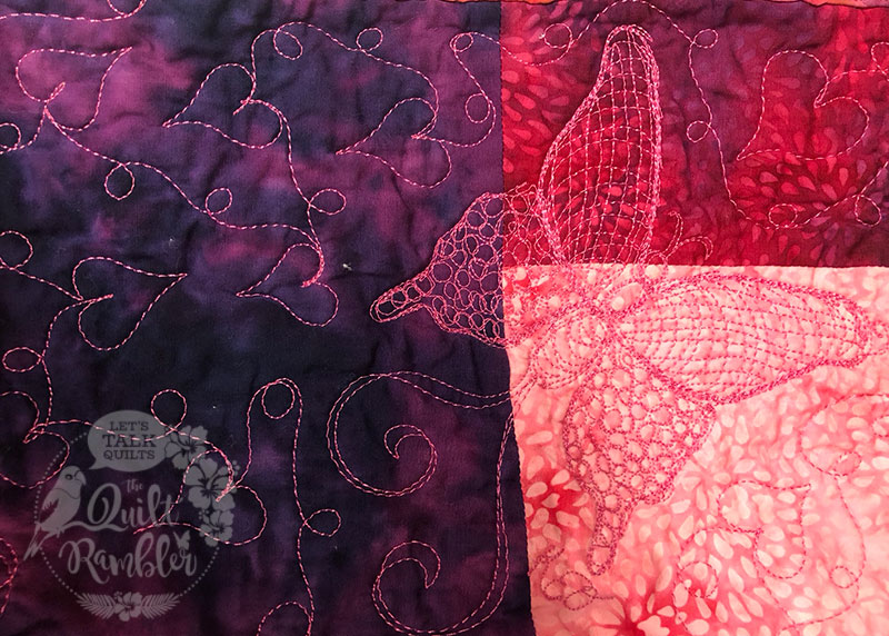 Thread play of Karen Overton's Signature butterfly quilted into a baby quilt