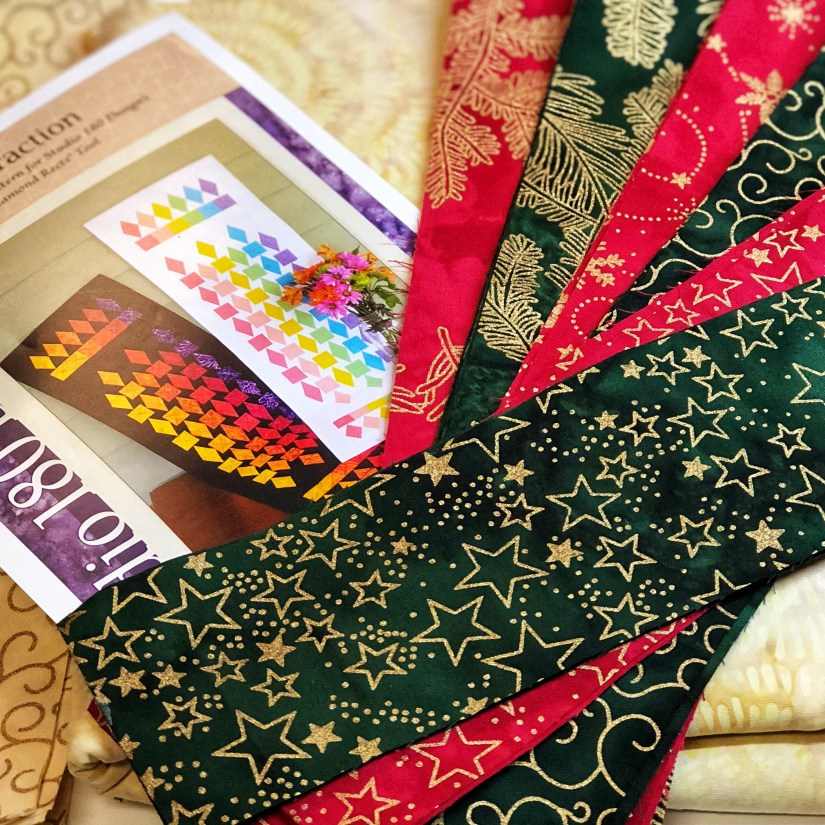 Christmas fabric to make Refraction quilt, a Studio 180 Design pattern