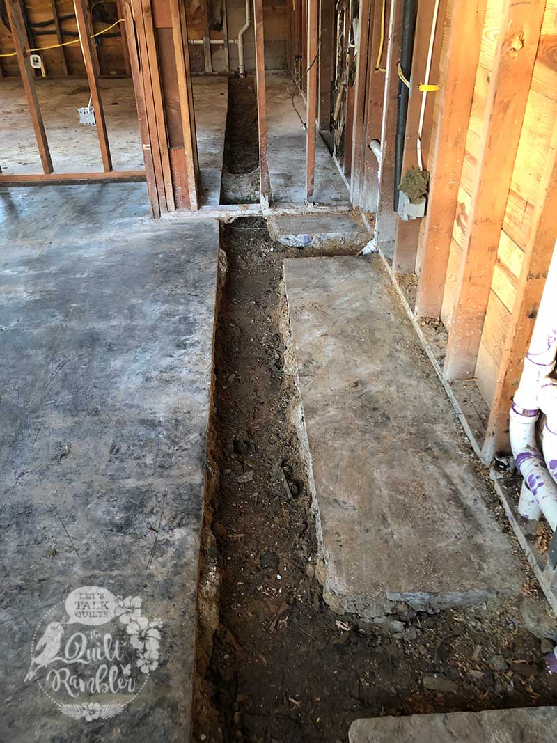 Foundation cut to allow for new drainage pipes