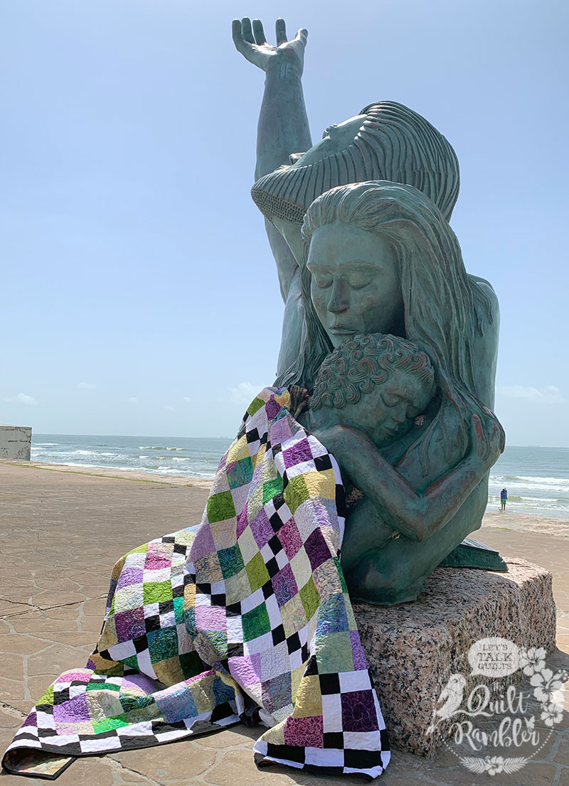 1900 storm statue Galveston Island with Checking The Boxes quilt