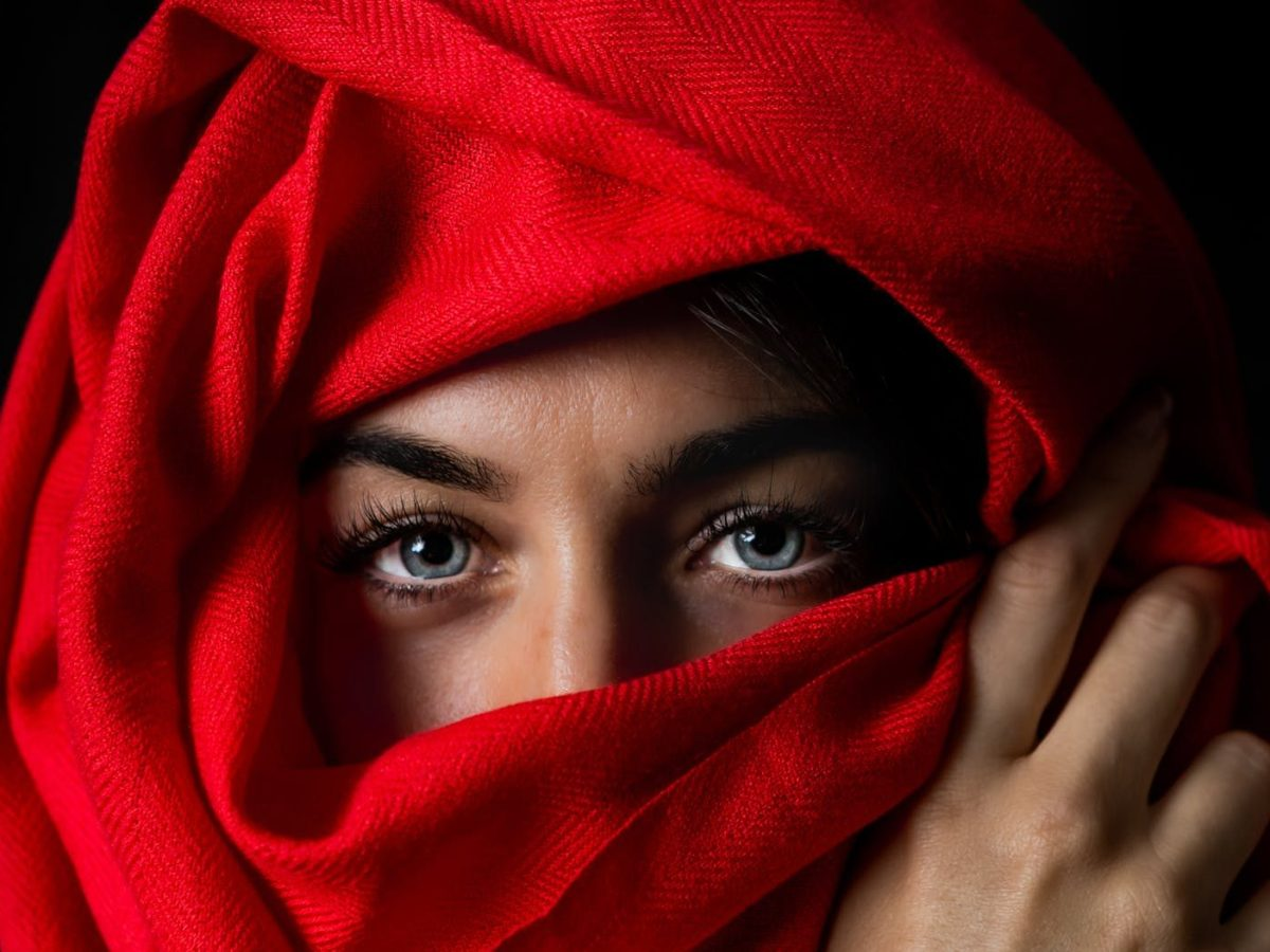 photo of person covered by red headscarf