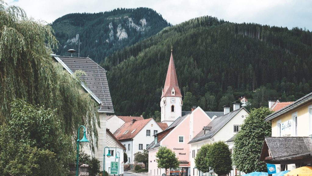 city with classic cottages in mountainous terrain